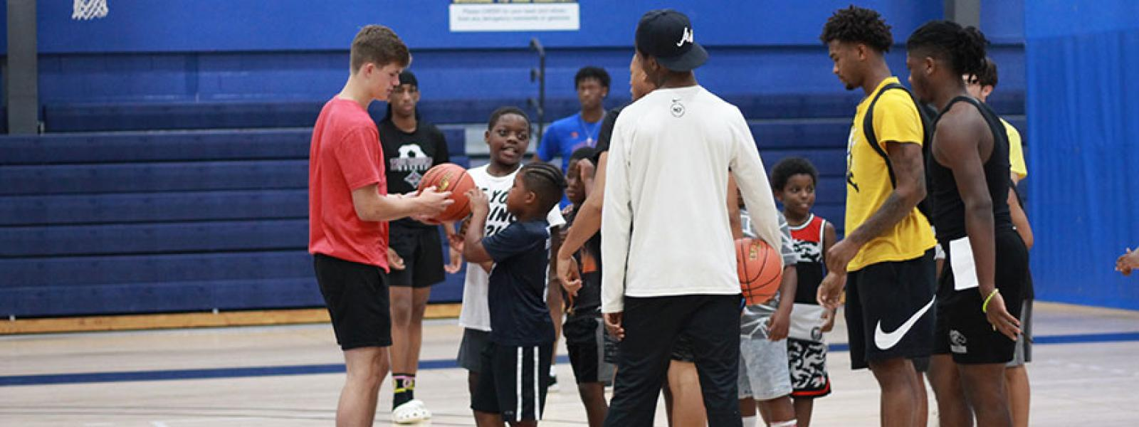 CIU Rams basketball players and local children at Hoop for Hope