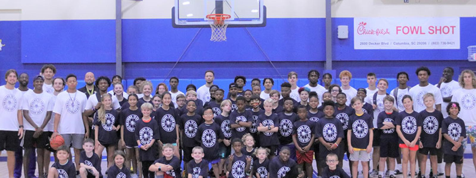 CIU basketball campers, players and coaches