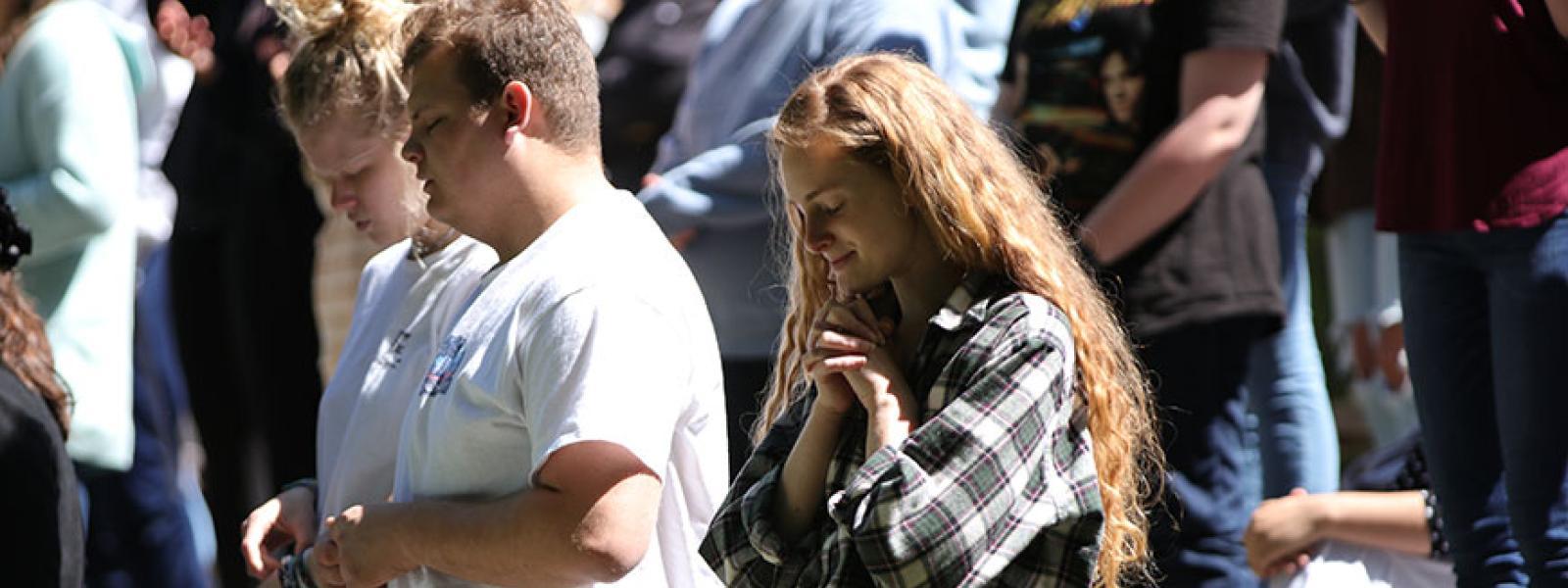 CIU students pray near the Prayer Towers.