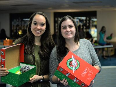 Katelyn Nichols (left) and Kylie Sutton display their Operation Christmas Child shoe boxes.
