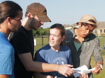 CIU students Josh Will, Darian Hair, Erin Gobbi and Caleb Joung react to Amazing Race instructions.