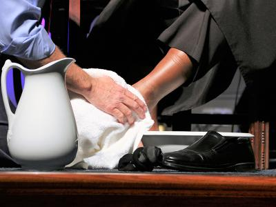 CIU President Dr. Mark Smith washes the feet of professor Dr. Andre Rogers.