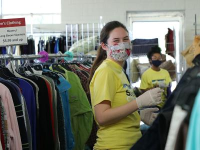 Kaitlyn Thompson sorts clothes at the Salvation Army thrift shop. (Photos by Kierston Smith)