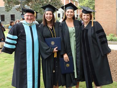 Graduates of the CIU Education program celebrate with professors.