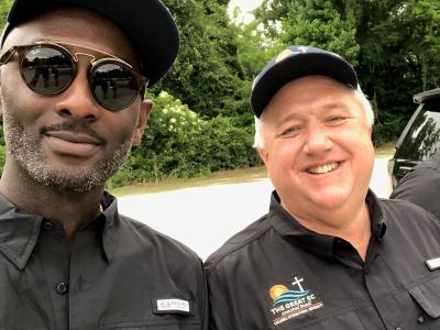 President Dr. Mark Smith (right) walking the coast in prayer with Trae Capers, assistant dean for spiritual formation.