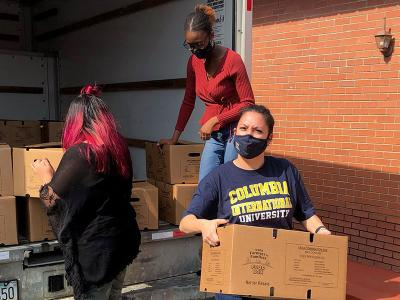 Gina Dickerson lends a hand at Temple Zion Baptist Church.