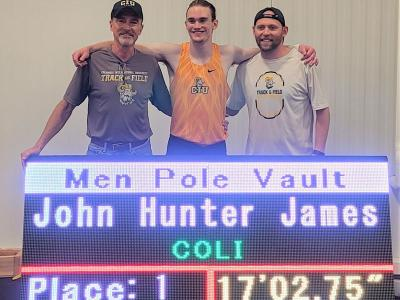 John Hunter James is flanked by Pole Vault Coach Rusty Shealy (left) and Head Coach Jud Brooker.