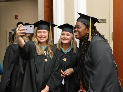 Three CIU students celebrate graduation.
