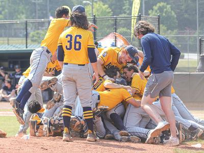 The Rams celebrate after the final out.