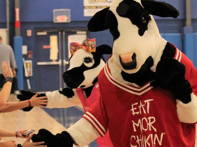 """The Cows help """"Pack the House"""" for CIU volleyball."""
