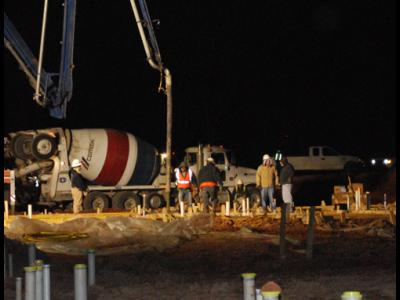 Construction crews pour concrete at 4 a.m.