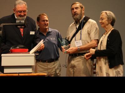 Dr. Jack Layman receives Kingdom Impact Award. Left to right: Director of CIU Al