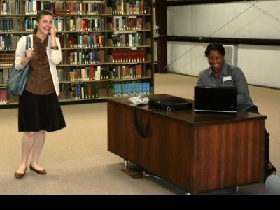 Student Elizabeth Gross (left) expresses delight as librarian Stephanie Solomon