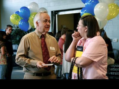 CIU Associate Dean of the School of Education, Dr. Milt Uecker (left), discusses